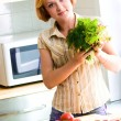 Young woman making salad — Stock Photo