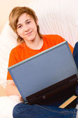 The teenager in an orange t-short — Stockfoto