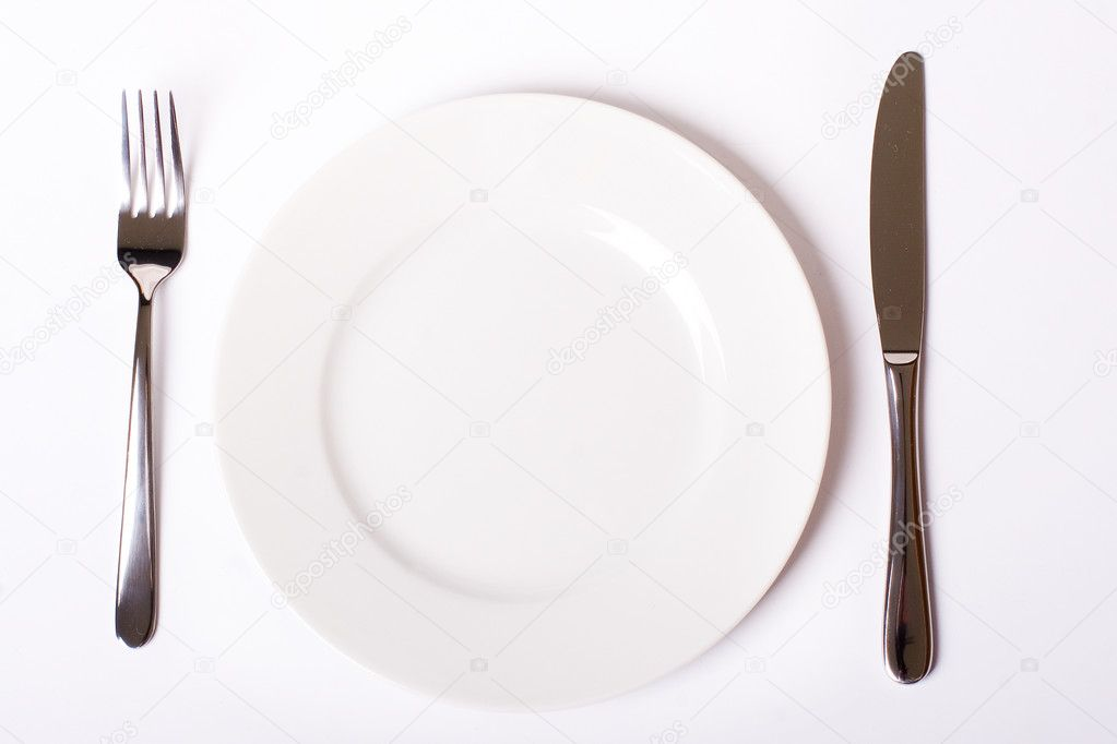 Plain white plate with knife and fork, with soft shadow  Stock Photo #2256425