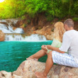 Couple near waterfall — Stock Photo