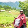 Rider on motobike at rainy day. Rural countryside — Stock Photo #1840028