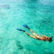 Young woman is snorkeling in tropical lagoon — Stock Photo #2276865