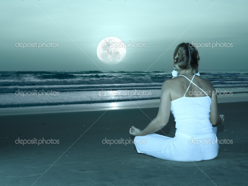 Woman is meditating at twilight time under moon — Stock Photo #2556071