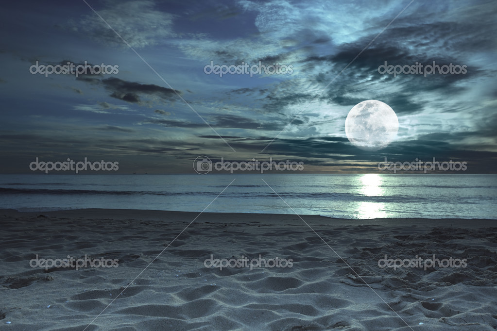 Beautiful beach at twilight time with moon in the sky — Stock Photo #2557584