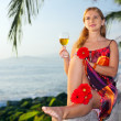 Young woman with glass of white wine - Stock Photo
