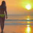 Woman at sunrise time — Stock Photo