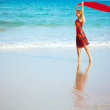 Woman with red sarong — Stock Photo