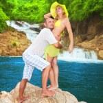 Couple near waterfall — Stock Photo