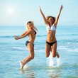 Jumping over waves — Stock Photo #2568798