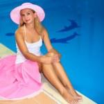 Woman near swimming pool — Stock Photo #2569913