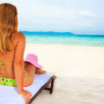 Woman sunbathing — Stock Photo