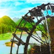 Bamboo water wheel - Stock Photo