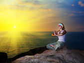 Meditation at sunset time — Stock Photo