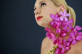Woman with orchid — Stock Photo