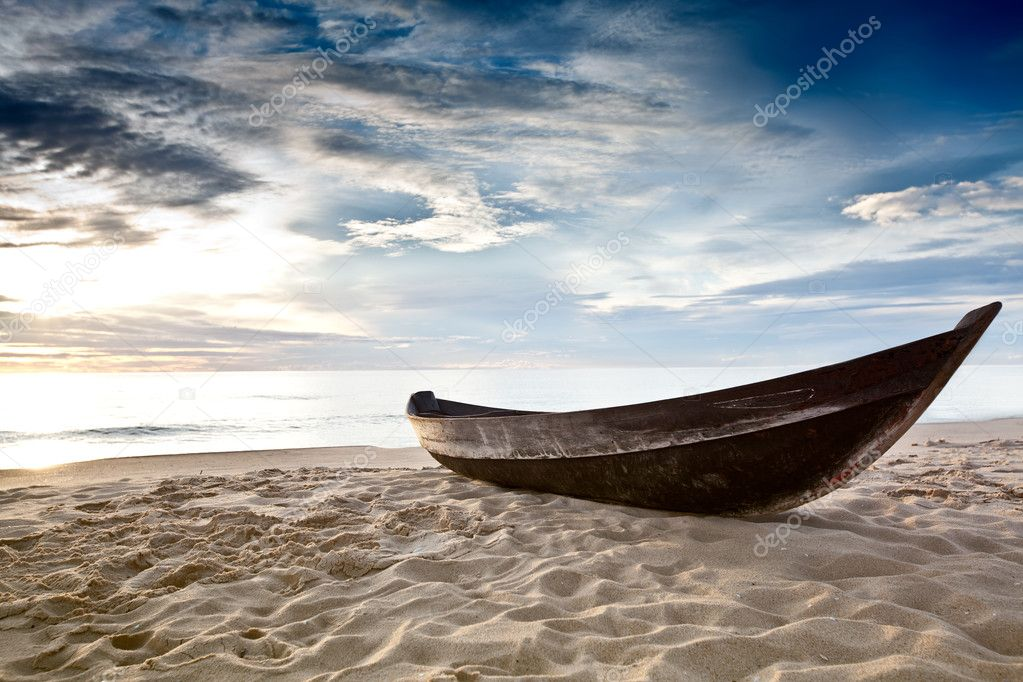 Old fisherman boat at sunrise time on the beach — Stock Photo #2575840