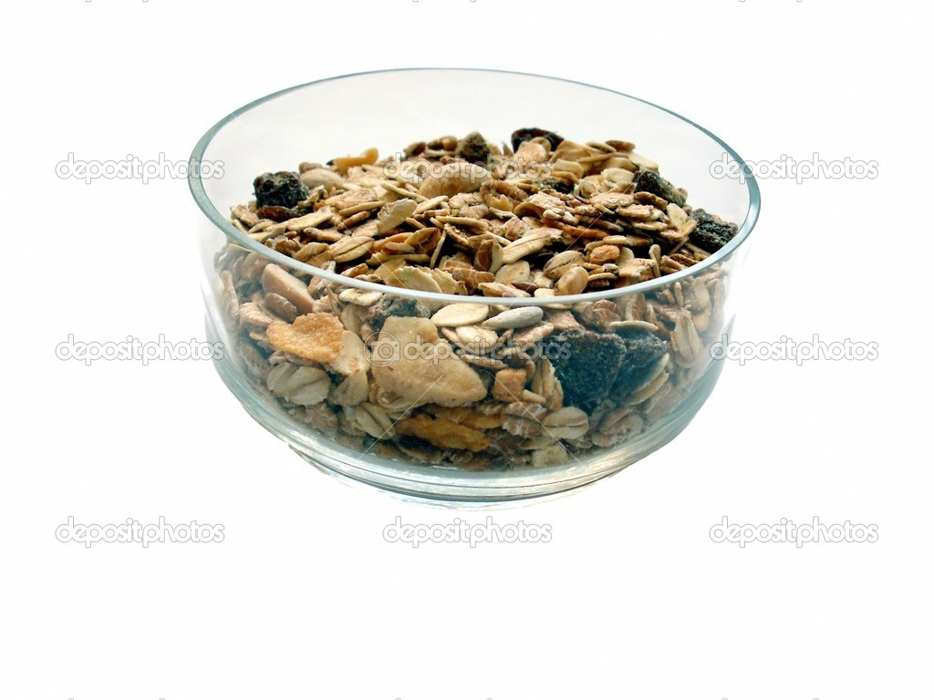 Multifruit muesli in glass bowl exhibited on white background  Stock Photo #1642653
