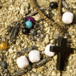 Royalty-Free Stock Photo: Necklace, beads and cross on the sand