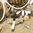 Stock Photo: Necklace, beads and cross on sand