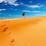 Sand dune climbing — Stock Photo #1594356