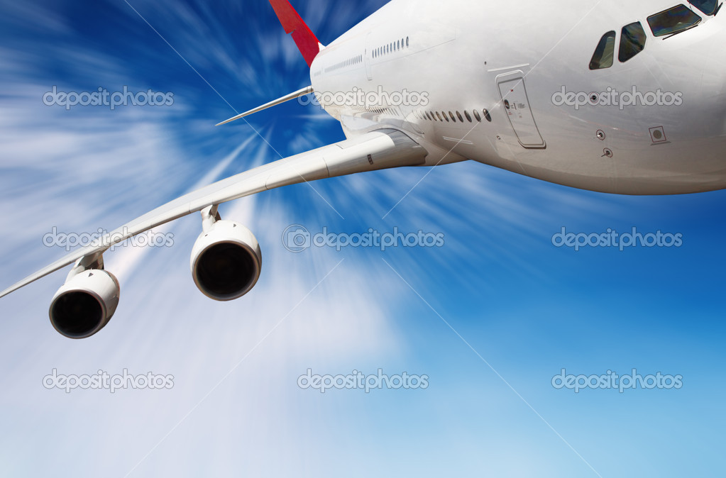 Jet airplane in the sky with motion blur  Stockfoto #1595092