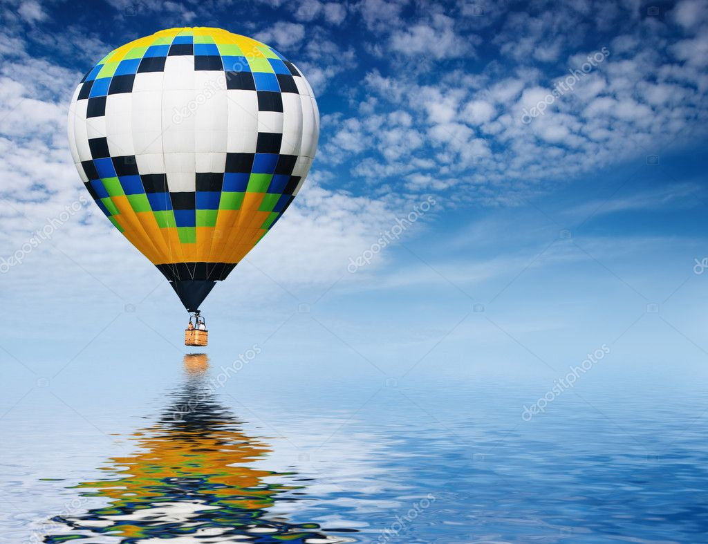 Hot air balloon flying in blue sky — Stock Photo #1607118