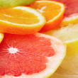 Citrus fruits background — Stock Photo