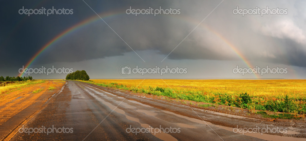 Landscape with country road and rainbow — Stock Photo #1612799