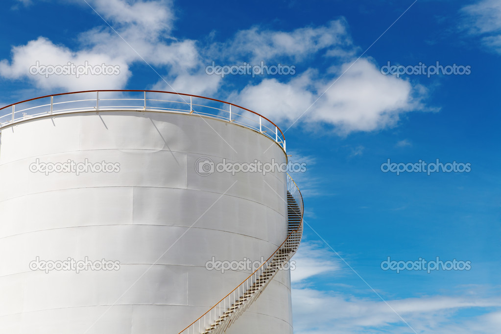 Industrial fuel tank against blue sky background — Stock Photo #1622659