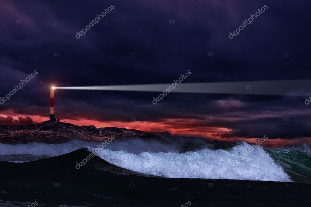 Lighthouse on the rocks in storm ocean  Stock Photo #2297261