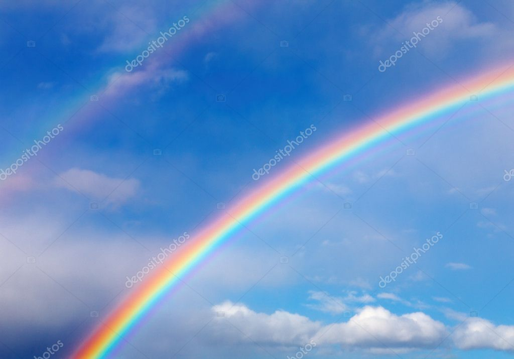 Blue sky with clouds and rainbow — Stock Photo #2298377