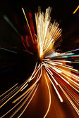 Car lights in motion blur — Stock Photo