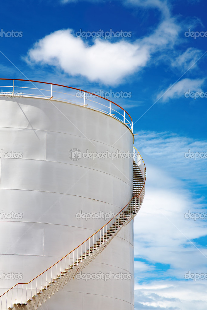 Industrial fuel tank against blue sky — Stock Photo #2515948