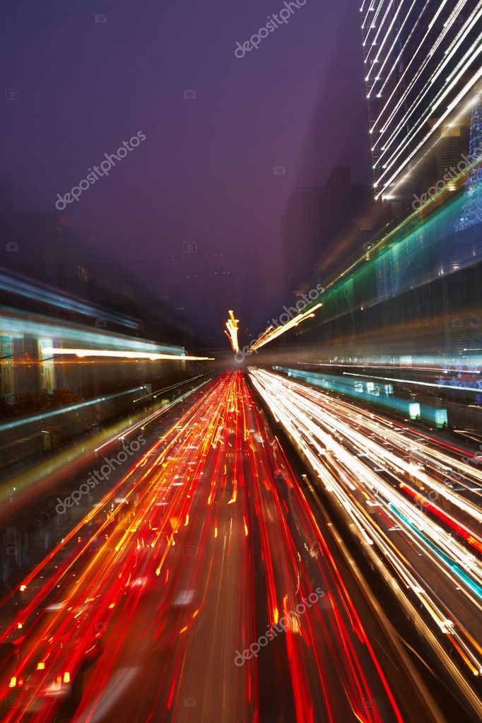 Night traffic in the city, car lights in motion blur with zoom effect — Stock Photo #2516617