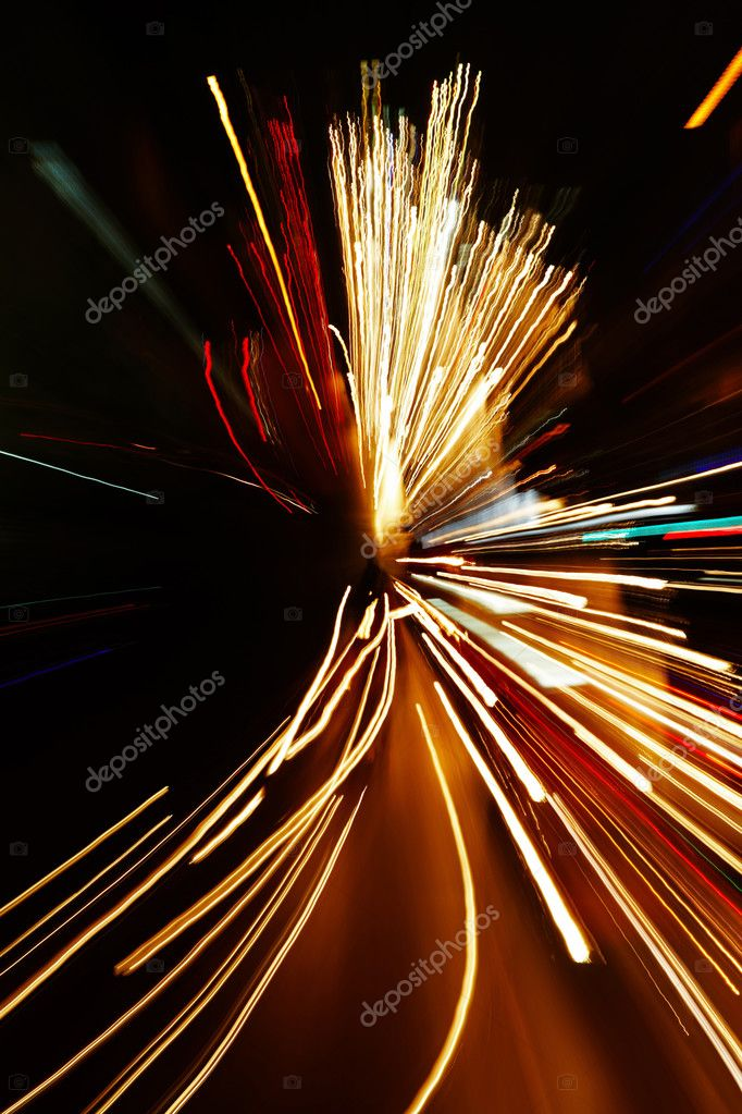 Night traffic in the city, car lights in motion blur with zoom effect — Stock Photo #2517125