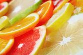 Citrus fruits background — Stock Photo