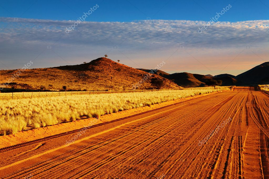 Road in Kalahari Desert at sunset, Namibia  Stock Photo #2652840