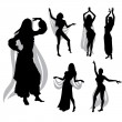Stock Vector: Belly dancers silhouettes