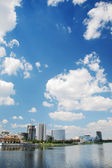 Summer urban landscape with clouds — Stock Photo