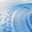 Snowmobile track on snow — Stock Photo #2071769