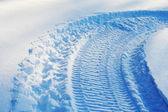 Snowmobile track on snow — Stock Photo