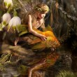 The girl and gold fish - Stockfoto
