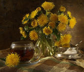 Bouquet from yellow dandelions — Stock Photo