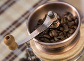 Coffee grains in a mill — Stock Photo