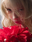 Girl and flowers — Stock Photo