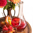 Grape red wine in the glass against the bottle and grapes — Stock Photo
