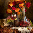 Still life with autumn flowers, grapes and wine — Stock Photo #2462062