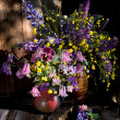 Daisies, buttercups, bluebells, and Aquilegia in a bouquet — Stock Photo