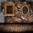 图库照片: Vintage frame on brick wall of old