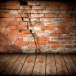Brick wall with a large crack - Stock Photo