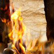 Ancient scroll on burns in the fire — Foto Stock
